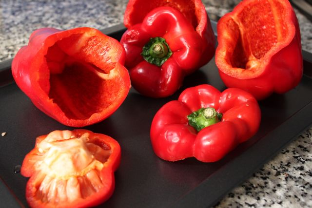 Capsicums cut up and ready to be stuffed with quinoa, zucchini and eggplant