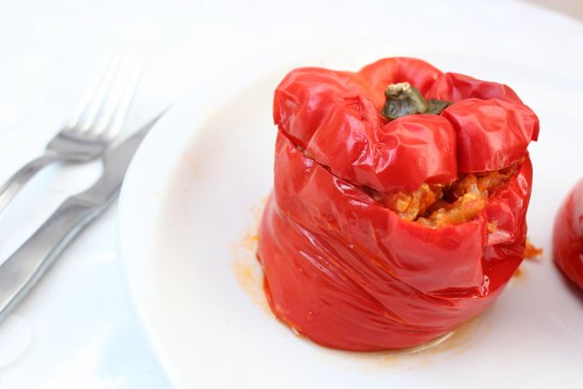Roasted capsicums stuffed with quinoa, eggplant and zucchini