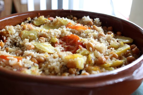 Arroz al horno or Valencian oven-baked rice, cooked in a traditional cazuela.