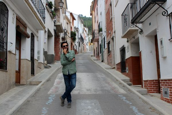 Fran stands in the streets of Agres, Spain
