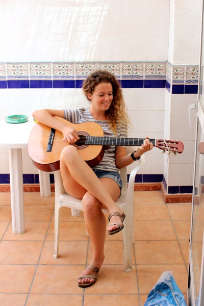 Paloma plays the guitar while we make Spanish gazpacho