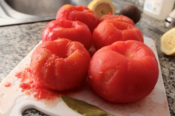 Tomatoes steamed from their skins and ready to be made into gazpacho