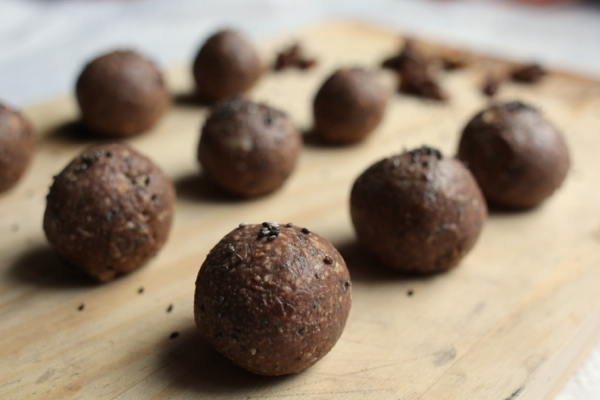 Vegan bliss balls with chocolate, banana, carob, walnuts and chia