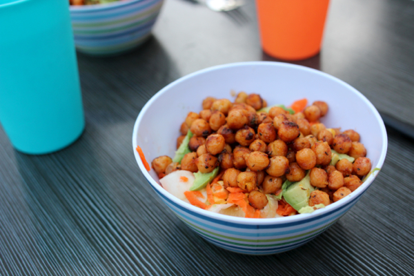 Spicy chickpeas with avocado, carrot, corn and zucchini noodle salad